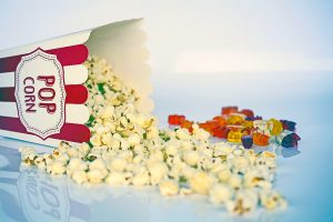 Ultimate COOL MOVIES List for Families - popcorn and gummies