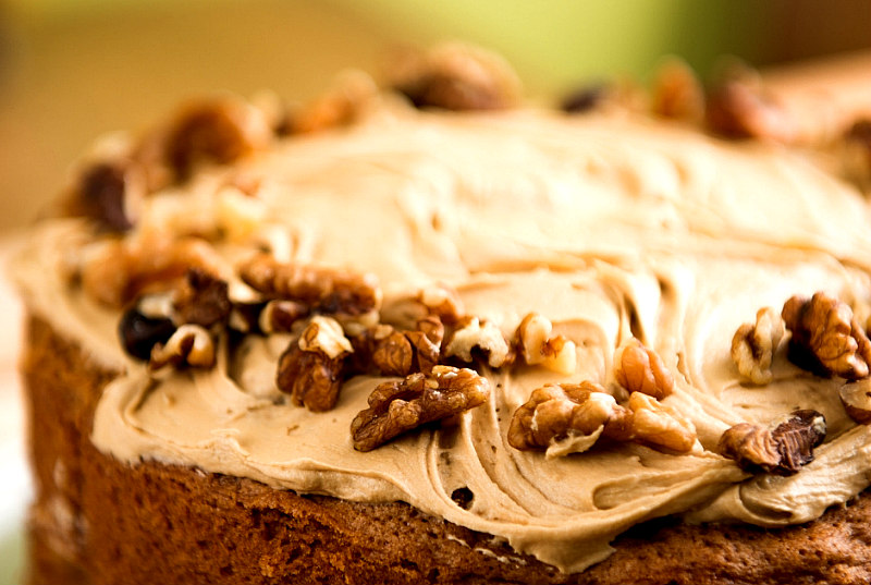 view of close up chocolate wacky cake with frosting and walnuts