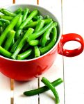 close up of how to cook green beans - in red mug