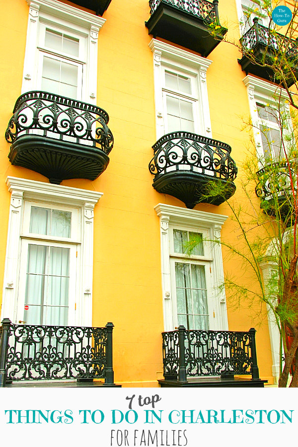 mustard yellow home with black iron balconies for things to do in charleston