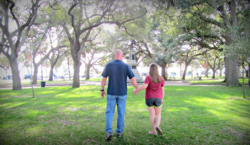 Father and daughter walking in White Point Gardens, holding hands - things to do in Charleston