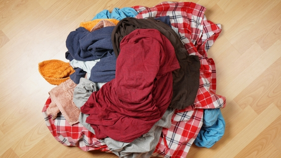 How to Get Organized Within Your Home For Good - pile of laundry