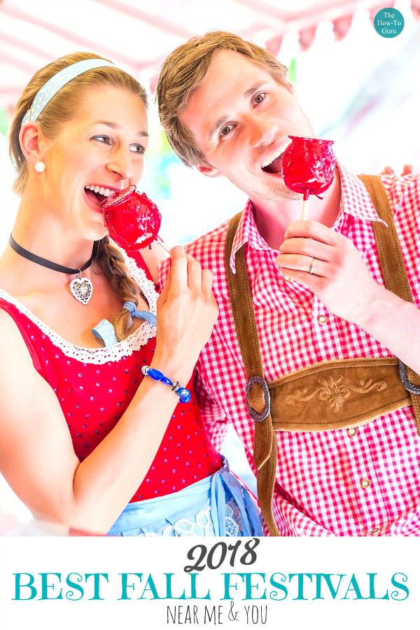 man and woman in german costume eating candy apples at fall festivals near me