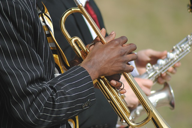 men in suits playing jazz instruments at fall festivals near me