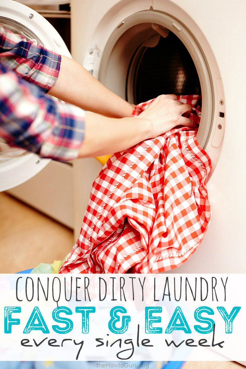 Putting dirty laundry into the machine with clothes hanging out