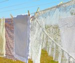 laundry on a clothesline for how to keep house clean