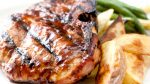 CLOSE UP OF EASY slow cooker pork chops infused with sweet and spicy barbecue sauce