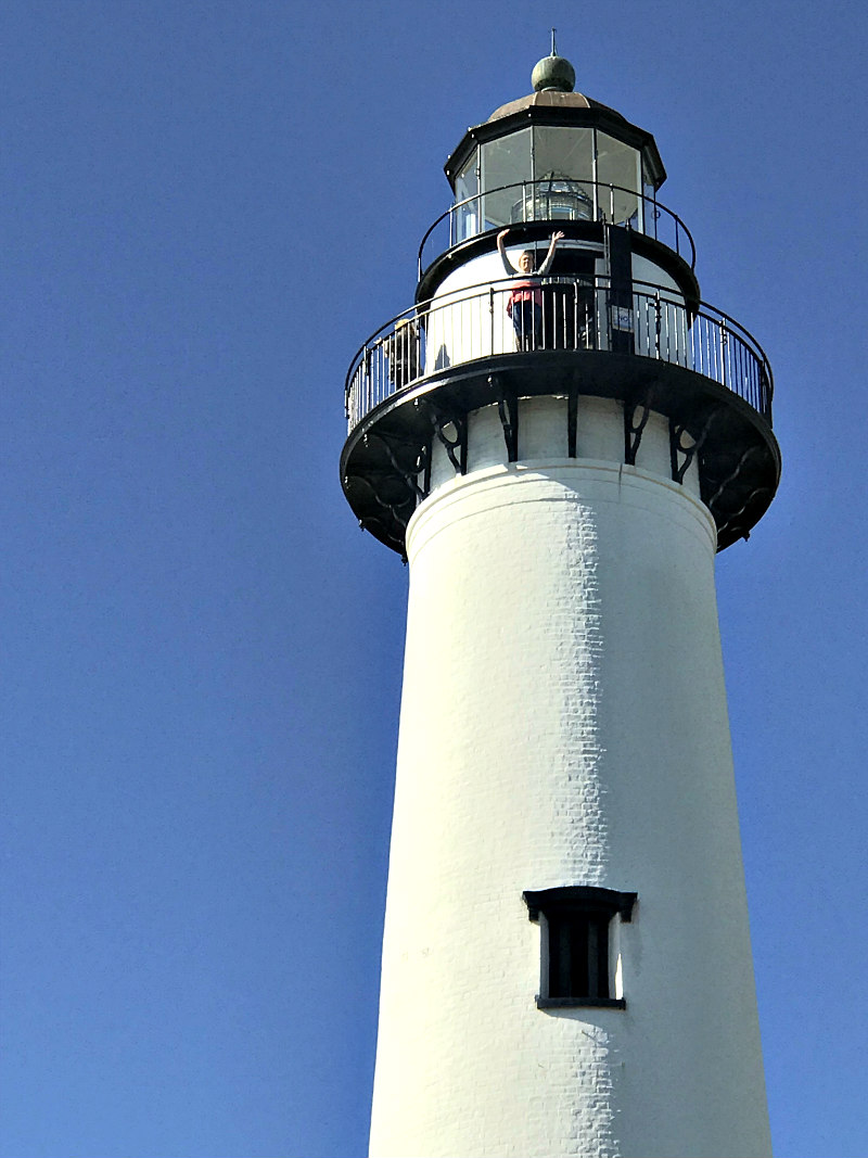 BEST Things to do on St Simons Island with older kids - Teen at top of St Simons Island Lighthouse