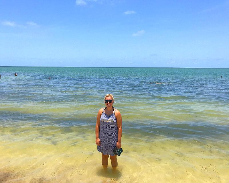 view of girl standing in Sombrero Beach ocean in Marathon, Florida