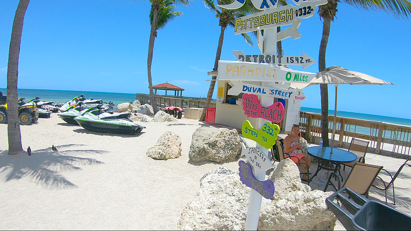 Key West beach with sign and jet skis for best East Coast beaches