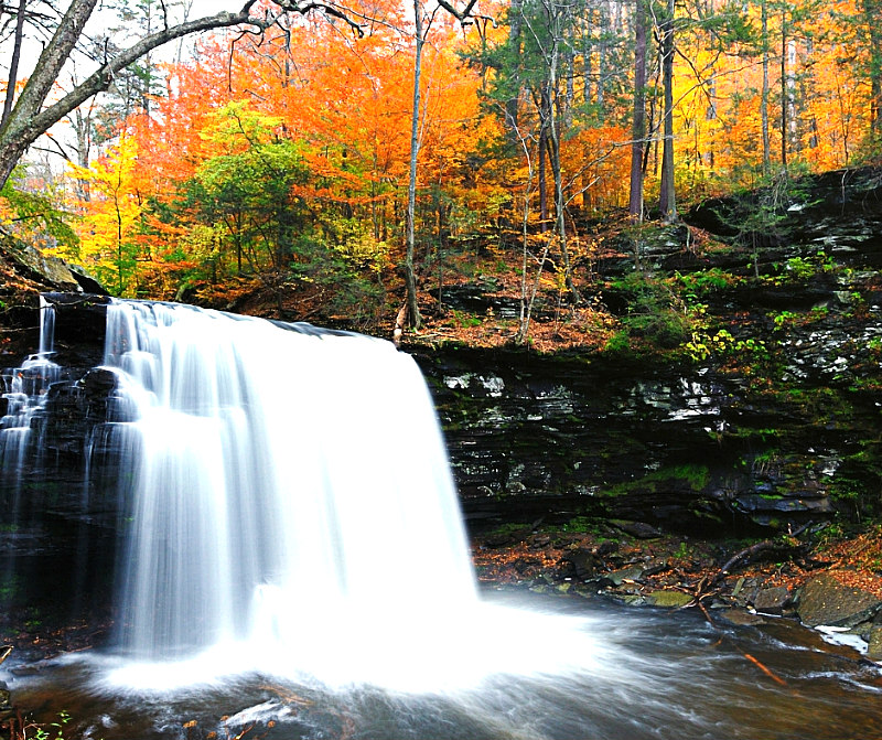 view of fall waterfall and fall foliage - best weekend getaways in the south