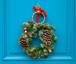 close up of Christmas movies 2018 teal door with wreath