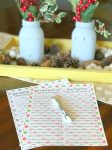 table with printable Christmas gift list on it with decorations