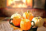 close up of pumpkin mugs for Thanksgiving menu in front of fireplace