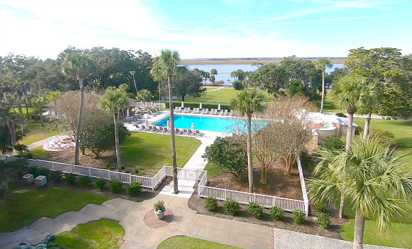view of Jekyll Island Club Resort balcony overlook of the pool and river