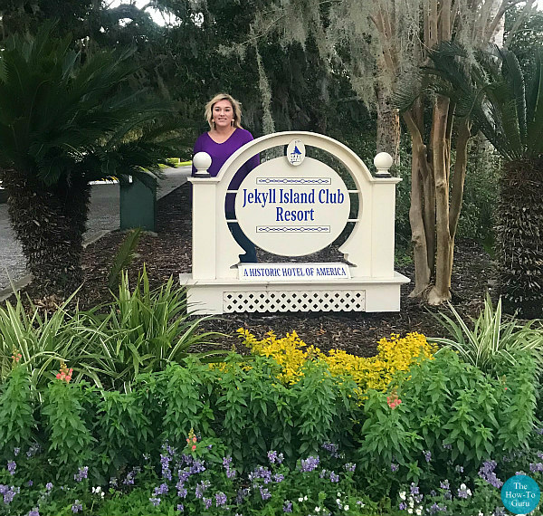 view of Jekyll Island Club Resort sign and girl