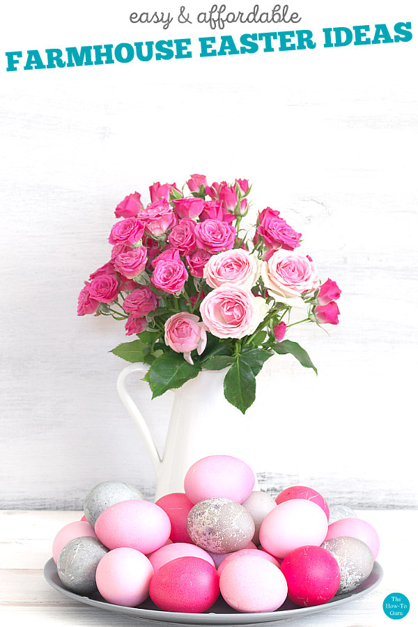 view of white vase, pink roses, and pink Easter eggs on table