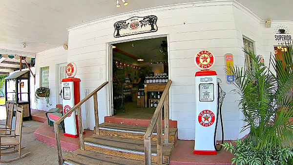 view of Carolina Cider Company's outdoor retro gas pumps in Charleston South Carolina