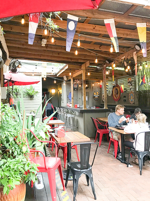 view of outdoor seating at Yellow Dog - things to do in New Smyrna Beach Florida