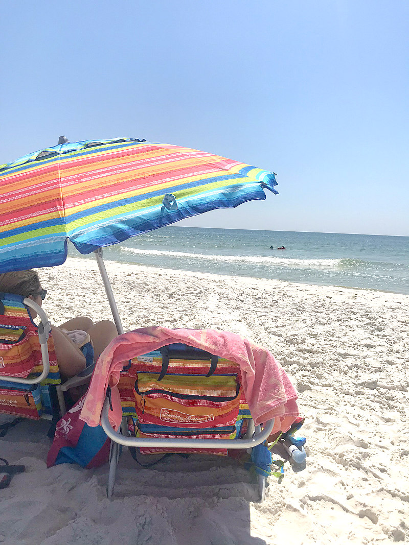 Tommy Bahama backpack chairs and umbrella with girl on Gulf Coast Beaches of Cape San Blas Florida
