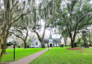 St. Simons Island Christ Church under spanish moss oaks and with green lawn