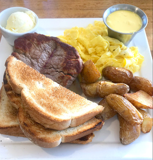 St. Simons Island ECHO restaurant serves up incredibly hearty breakfasts with this steak, eggs, potatoes, and toast dish!