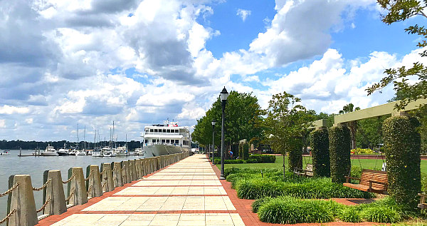 Beaufort South Carolina Waterfront Park Views of swings, greenery and boats in Beaufort River
