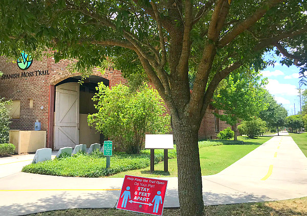 Beaufort Spanish Moss Trail and brick building with social distance red sign