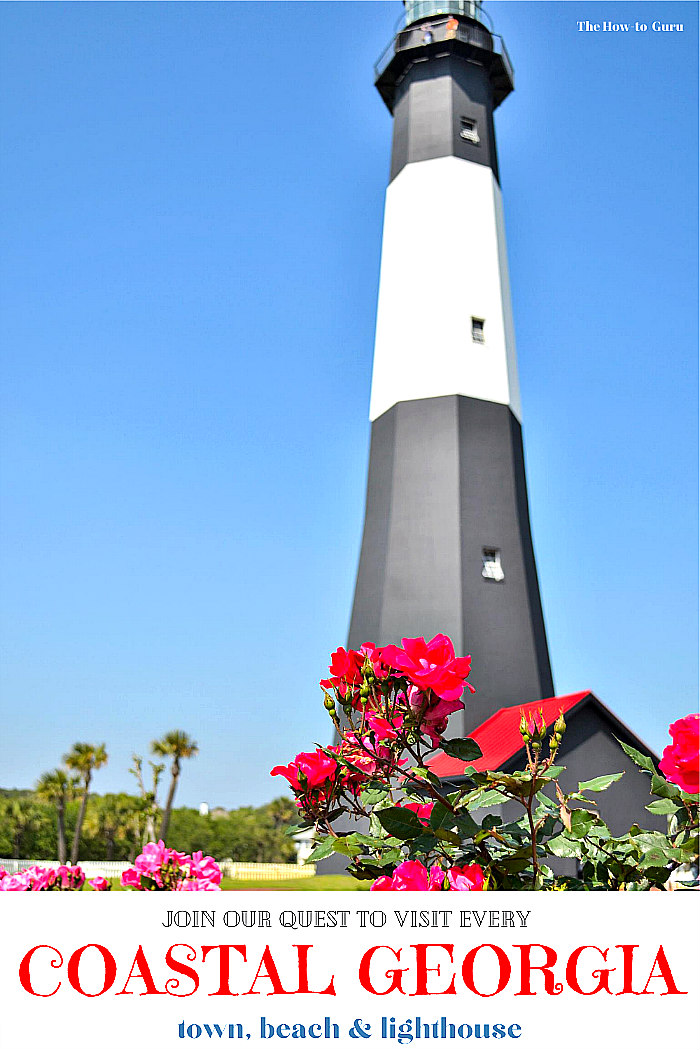 Black and white stripped Tybee Island Lighthouse and house with pink flowers in forefront and trees in background