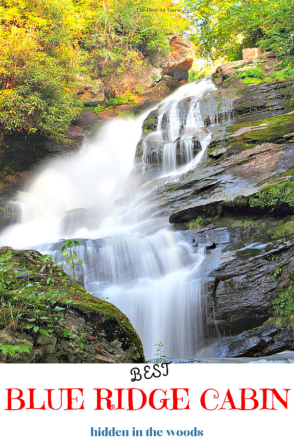 North Georgia waterfall in the heart of Blue Ridge Mountains. Cascading water flowing over jagged rocks with green and yellow tree leaves.